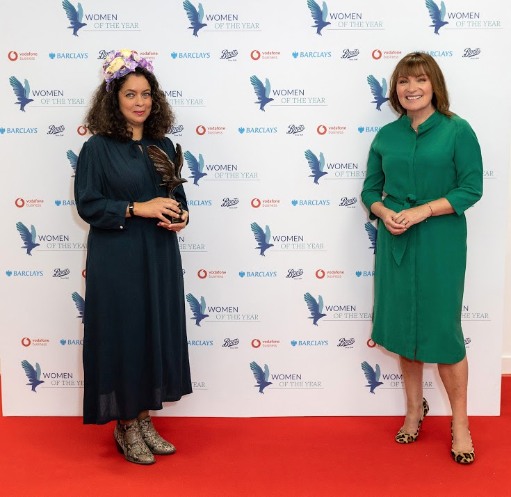 Lorraine Kelly (Presenting The Women of the Year Community Spirit Award) and Adwoa Dickson (Amies Freedom Choir, project director . Winner - The Women of the Year Community Spirit Award) (Photo by David M. Benett/Dave Benett/Getty Images for Women Of The Year Awards )